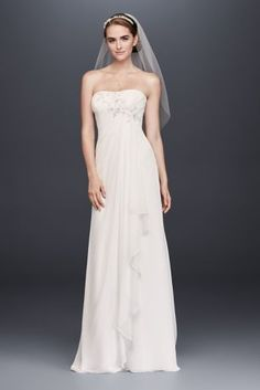 Soft and easy, this draped chiffon wedding dress will nearly float down the aisle. The pleated bodice features a crystal- and pearl-beaded lace applique that cascades down the skirt.  David\'s Bridal