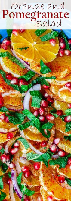 Easy Mediterranean Orange and Pomegranate Salad | The Mediterranean Dish. A simple, bright and refreshing orange and pomegranate salad with a little red onion and fresh mint. A honey dressing on top brings it all together! Perfect for holiday dinners or any day next to meaty or fish entrees. Get the recipe on The MediterraneanDish.com #Skinny4LifeEats™