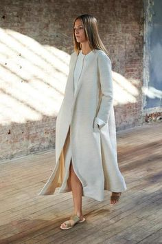 cream flowing coat + gold double strap sandals