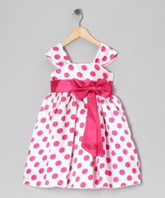 Little ladies will revel in the charming style of this party-perfect dress. Boasting a big bow, easy-on back closure and tie at the waist, this piece pulls out all the precious stops.