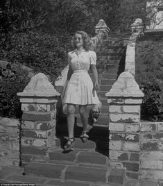 Taking a stroll: Davis, whose career spanned decades, was snapped wandering down the steps of her house followed by her pet Pekingese, Popeye the Magnificent