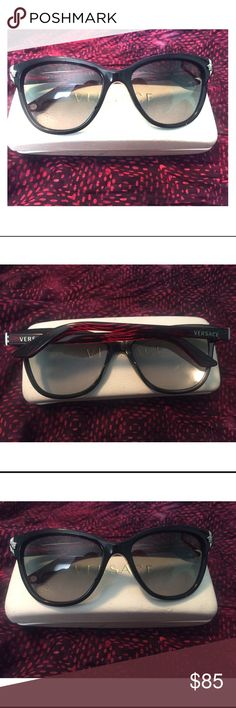 Versace Sunglasses Style 4228 Black Sunglasses with Medusa head details, and a black/red frame. Excellent condition with minimal signs of wear and minor scratches. Comes with glasses case which is a little bent out of shape, but absolutely does the trick in protecting the frame. The frames will arrive to you cleaned, sanitized and ready to wear. These are real Versace sunglasses purchased at Sunglasse Hut Versace Accessories Sunglasses