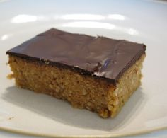 Almond Coconut Bars 1 cup Shredded Unsweetened Coconut 2 cups whole Raw Almonds 1/2 cup Almond Butter 2/3 cup extra virgin coconut oil (This is a great place to use Gold Label) 1 Tbsp Coconut Flour 1/2 tsp Salt 1 1/2 Tbsp Blackstrap Molasses 1 Tbsp Vanilla Extract 3 oz 85% dark chocolate (I use two squares of Unsweetened Chocolate and one square of Semi-Sweet Chocolate)