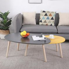 With an interesting design, these modern inspired coffee tables are sure to become conversation starters. A glossy finish tops off this eye-catching nesting table set while its solid wood legs add rustic appeal. You'll receive a set of two tables. Select your favorite style, to create a living room that is a fashion statement all its own. Create a cozy reading nook, with a table perfect for magazines and that cup of coffee. Made from Waterproof Durable Scratch resistant #table #coffetable Round Wood Coffee Table, Coffee Tables, Sofa Side Table, Sofa Bed, Point, Design, Furniture, Tea, Home Decor