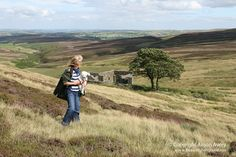 I visited this area in 1990 and would love to go back...this time with my camera.  Visit this woman's site to see other beautiful images of the amazing landscape. (Top Withens, Haworth Moor, North Yorkshire (Honey and me) by Beautiful England, via Flickr)