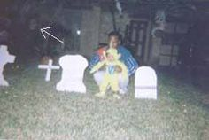 This is an photograph of a graveyard in India. Notice the face marked with an arrow. This photo was taken by the NDGRCLUB (New Delhi Ghost Resercher's Club).