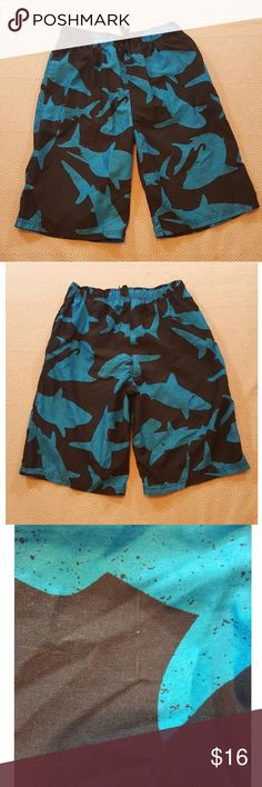 "Swim Trunks--Cherokee--Young Men's Fun Shark Frenzy Pattern!😲 Shell/Lining 100% Polyester  Elastic waist with adjustable tiestring 14"" Net lining Inseam 10-3/4"" Hardly used (rainy Seattle area)! Small run on backside (3rd pic), not noticeable Side pockets (no closure) Cherokee Swim Swim Trunks"