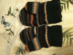 My new mittens that I made this weekend.  Old sweater and some creative stitching.