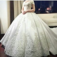 Traditional wedding gowns like this lovely ball gown style can be customized to a brides personal taste. As dressmakers of affordable custom #weddingdresses we can make any type of style you need. We can also make designs inspired by haute couture wedding dresses that cost much less than the original. Contact us at www.dariuscordell.com/