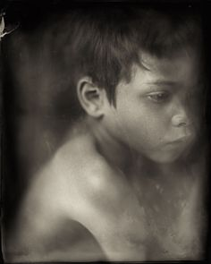 I make portraits on colored glass and aluminium plates. I use an old photographic technique called wet plate collodion. It is quite a challenging technique, particularly when working with children.