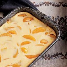 Peach Kuchen with Sour Cream - I make Kuchen frequently. It is an upscale cobbler, with a cake-like bottom and sweet cream topping that is very tasty and satisfying.