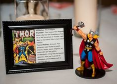 Superhero Table numbers maybe frames with superheroes and brief story on candle table and one for each groom!