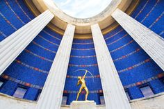 """""""The Archer"""" – An 11-foot-tall statue at the entrance to the Hall of State building in Dallas, TX. Photo by Stephen Masker.   Archer, Art Deco, Dallas, Fair Park, Texas Photography, Wall Art, Hall of State, Freedom, Fine Art Photography, Bow and Arrow, Blue, Gold, DFW Photography"""