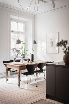 A White Scandinavian Apartment With A Sleek Dark Grey Kitchen - The Nordroom