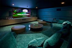 Home Design. Alluring Modern Entertainment Room With Green Sectional Couch Combined Rounded Glass Table Featuring Mounted Big Screen In Long Oaks Storage For How To Design A Home Theater Room Ideas. Have Family Entertainment With Best Home Theater Design Home Theater Basement, Best Home Theater, At Home Movie Theater, Home Theater Rooms, Home Theater Design, Cinema Room, Cinema Theatre, Cool Basement Ideas, Modern Basement
