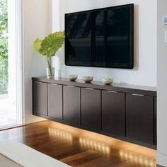 under the tv cabinetry