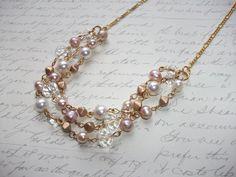 Pearls and crystal multi strand gold necklace de la boutique BijouxdeBrigitte sur Etsy