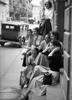 fashion models rest on a street corner by Milton Greene, Milano Italy 1951