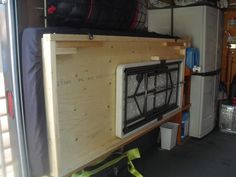 cargo trailer fold down bed - note the fold up table stored underneath!