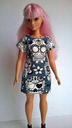Teal colored curvy Barbie dress black/white skull motifs