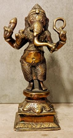I bought this lovely Ganesh statue on my first visit to Kathmandu in 1980.  You can buy statues of Ganesh at  http://bringingitallbackhome.co.uk