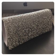 Silver Clutch Sparkly, chic silver clutch. Just what you need to complete your sophisticated evening gown look. Perfect for prom, homecoming, galas, etc. NWOT WINDSOR Bags Clutches & Wristlets