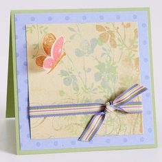 Celebrate Mother's Day and spring at the same time with this lovely layered card. Fold a rectangular piece of cardstock in half and layer square cuts of patterned paper on top. A three-dimensional stamped butterfly and multicolor ribbon finish the card./