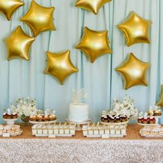 """A """"Twinkle Twinkle Little Star"""" themed baby shower calls for sparkly linens and gold star shaped balloons!"""