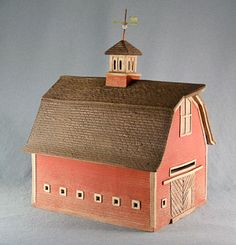 """Gambrel Barn with Cupola and Small Square Windows. """"By the late 19th and early 20th centuries, some gable-front barns were being built with gambrel roofs which allowed for more storage of hay"""""""