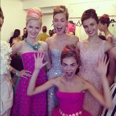 backstage at de la renta.  and even though these girls are wearing gorgeous dresses, their best accessories yet are their smiles!
