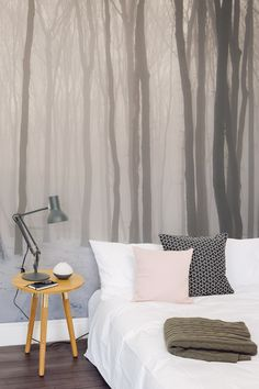 Lay your sleepy head under this beautiful forest wallpaper mural. A hazy forest landscape will bring depth and intrigue to your interiors. Perfect for creating a tranquil atmosphere in the bedroom or living room.