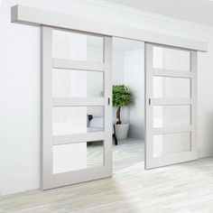 Surface Sliding Doors Thruslide Surface Cayman White Primed Sliding Double Door and Track Kit - Clear Glass - Lifestyle Image. Sliding Door Panels, Sliding Pantry Doors, Double Sliding Doors, Sliding Door Design, Double Barn Doors, Sliding Barn Door Hardware, Mirrored Sliding Closet Doors, Modern Sliding Doors, Solid Doors