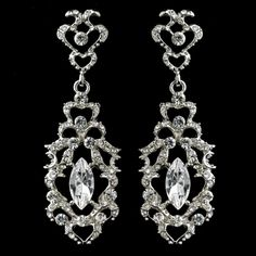 "Add a touch of vintage elegance to your wedding day ensemble with these sensational bridal earrings. The details of these earrings feature shimmering clear rhinestones encrusted in rhodium plating that glisten and shine in the light. These glamorous earrings are a perfect addition to your modern, classic, or vintage-inspired wedding.2 1/2"" x 7/8"""