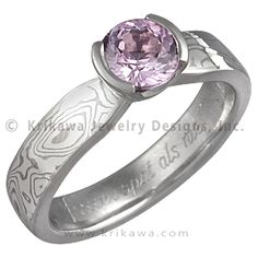 Mokume Solitaire Tapered Engagement Ring with Pink Sapphire - This simple yet enchanting ring has a classic design with a contemporary twist. The band has a uniform width until it intersects the head with an elegant taper. The setting tapers down to the band allowing for the unique engagement ring to sit flush next to a flat wedding band. - This Mokume Solitaire Tapered Engagement Ring has a pink sapphire in a semi-bezel.  The band features White mokume and is high polished.  The ring has…