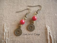 "Feng Shui Earrings  Made with little Chinese coins and coral beads. Hang on brass toned ear wires. Measure 1.5"" long Feng Shui is a Chinese art and science about the balancing of energy to promote health and fortune."