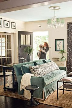 Hang art above cased openings to draw the eye up and make the ceiling look even higher. Here black a... - Photo: Laurey W. Glenn, Styling: Heather Chadduck,
