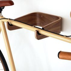 Hang your bike on the wall with one of these molded plywood Bike Racks. The leather soft grip keeps your bike frame protected while it's hung. Bike Hooks, Bicycle Rack, Wood Bike Rack, Bicycle Tools, Wall Mount Bike Rack, Bike Mount, Bike Hanger Wall, Indoor Bike Rack, Indoor Bike Storage