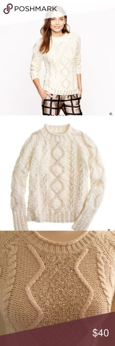 J Crew Hand knit Beaded Cable Sweater Even a rugged favorite like the fisherman sweater deserves a little glamming up. Shimmery silver bugle beads—all applied by hand—highlight the intricate Aran cable designs. For added luxury, the sweater is completely hand knit, which creates a more pronounced texture and makes it truly one of a kind.  Mercerized wool. Long sleeves. Rib trim at neck, cuffs and hem. Hits at hip. Dry clean. Import. Item 22686. J. Crew Sweaters Crew & Scoop Necks