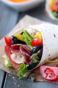 Take your Classic Italian Sub or Hoagie to new heights with loaded wrap sandwiches. Genoa salami, capicola, sandwich pepperoni, provolone, fresh veggies and a handful both each of black olives and pepperoncini. Sure to be your new lunchtime favorite!