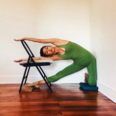 DETAIL + DEPTH | This next pose continues the progression of modified Parighasana, from the least side bend and hamstring stretch to the most. Take the bottom hand to the chair seat, and place the top...