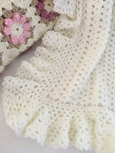 This lovely baby blanket has a timeless quality. It is light and lacy and is accented with a huge lightly ruffled border. It would be a welcome and sweet gift for a little newborn.