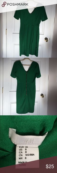 H&M green dress This H&M formal dress has a really flattering cut and beautiful design with the low v neck in the back. Size 8. Fully lined. Has a small spot that looks like would come out with the next wash. Dresses
