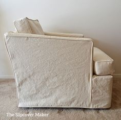 Casual natural canvas slipcover updates 1970's Henredon club chair.