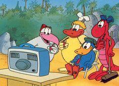 Kijk uit malloot, Een kokosnoot. Wie laat ons lachen, gieren? Ovide en z'n vrienden. Wat zij ook doen. We leven mee. Ja, met Ovide's vrienden op tv, op tv!