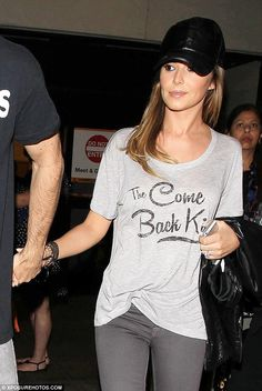Something to get off her chest? Cheryl Fernandez-Versini jokingly labelled herself 'The Come Back Kid' in a cute slogan T-shirt