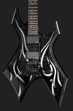 BC Rich Kerry King Signature Wartribe - warlock style with maple thru-neck body, ebony fretboard, 24 jumbo frets, 1x thomann EMG 81 and 1x EMG 85 active humbucker pickups with PA2 preamp, Kahler tremolo. Colour: Onyx with Grey Fire Graphic