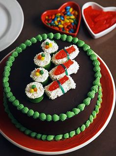 A birthday cake for sushi lovers.  I wonder if that's wasabi around the edge.