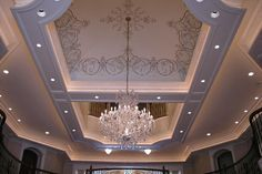 Elegant #chandelier and ceiling detail. Cost details for this new home construction available.