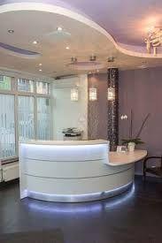curved white reception desk More - Curved Reception Desk, Salon Reception Desk, Reception Desk Design, Office Reception Area, Spa Reception, Reception Counter, Medical Office Design, Healthcare Design, Receptionist Desk