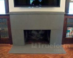 Image result for concrete fireplace surround